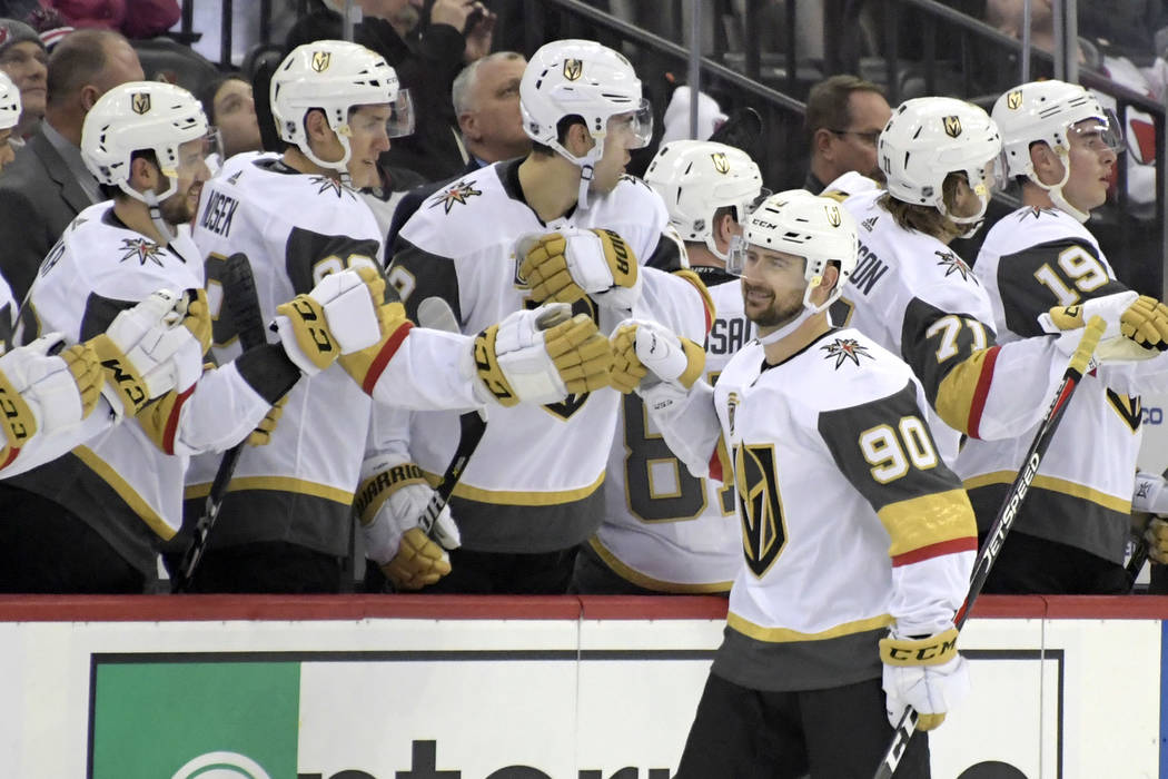 Vegas Golden Knights left wing Tomas Tatar (90) celebrates his goal with teammates during the second period of an NHL hockey game against the New Jersey Devils, Sunday, March 4, 2018, in Newark, N ...