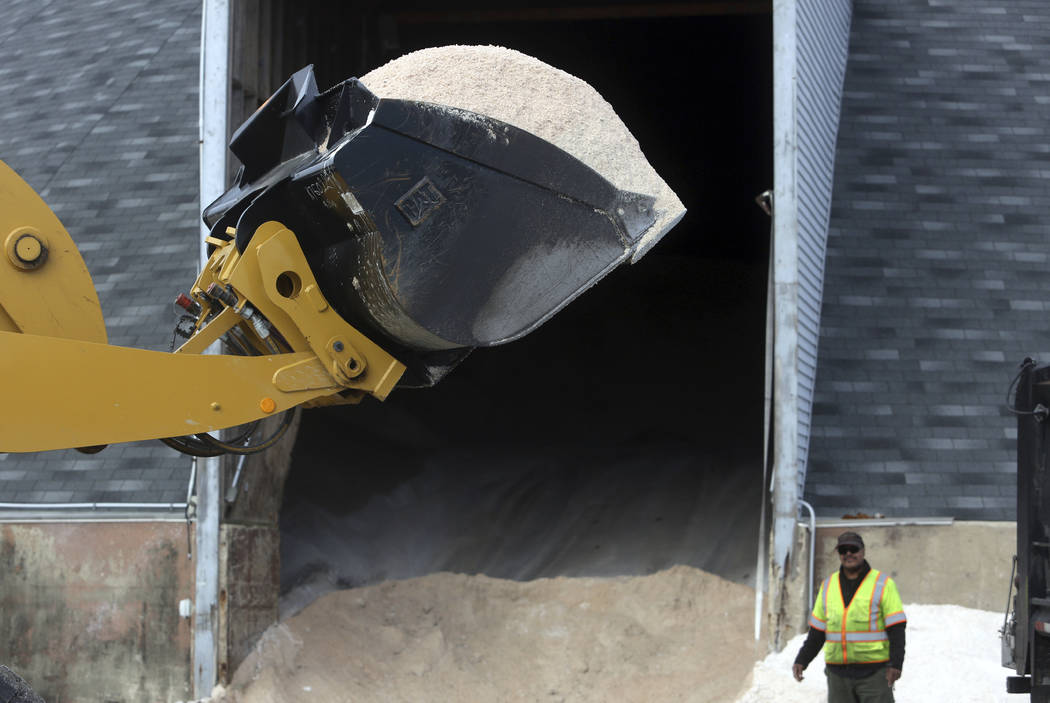 Streets Department crews load rock salt in preparation for an expected winter snowstorm in Philadelphia, Tuesday March 6, 2018. Philadelphia officials say all schools and municipal offices will be ...