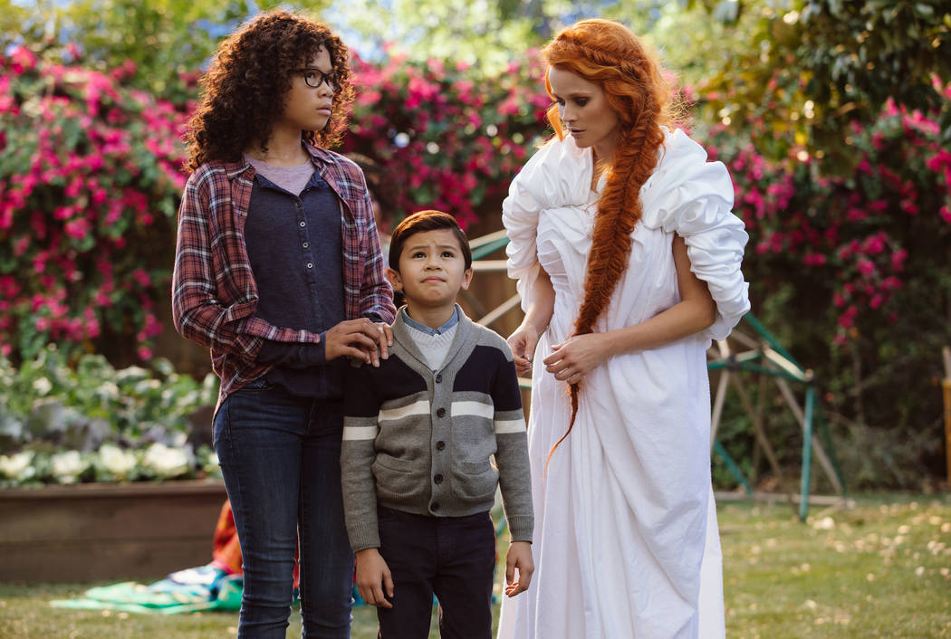 "Storm Reid is Meg Murry, Deric McCabe is Charles Wallace and Reese Witherspoon is Mrs. Whatsit in Disney's ""A Wrinkle in Time."""