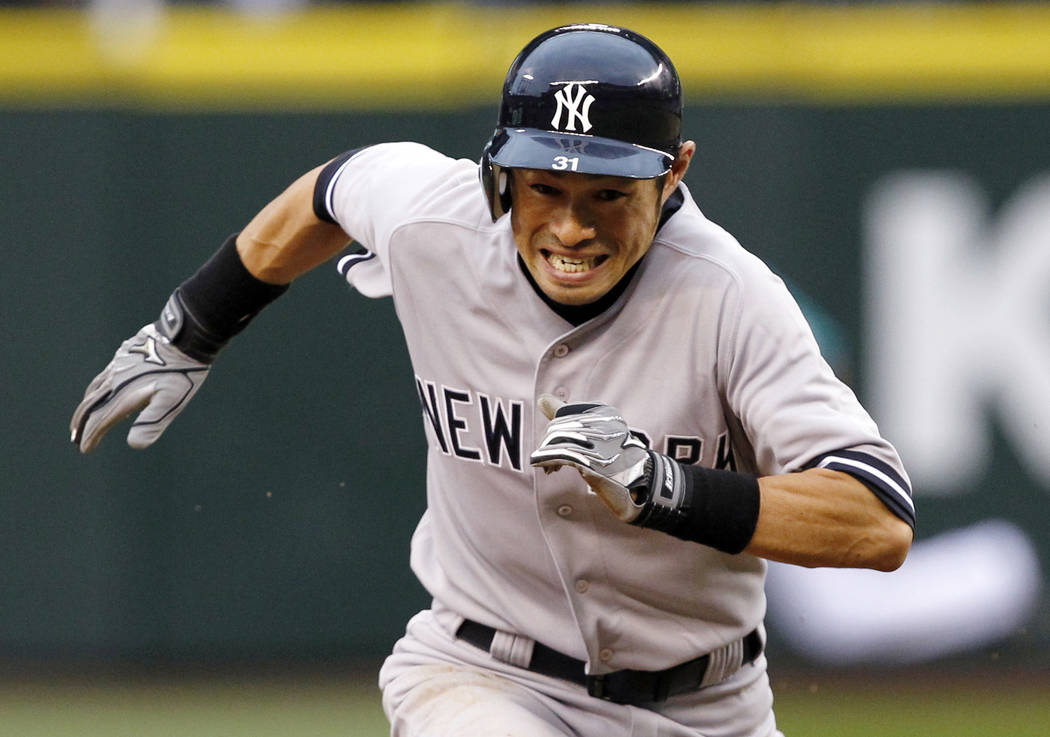 In this July 23, 2012, file photo, New York Yankees' Ichiro Suzuki races to third against the Seattle Mariners in the fourth inning of a baseball game in Seattle. (AP Photo/Elaine Thompson, File))
