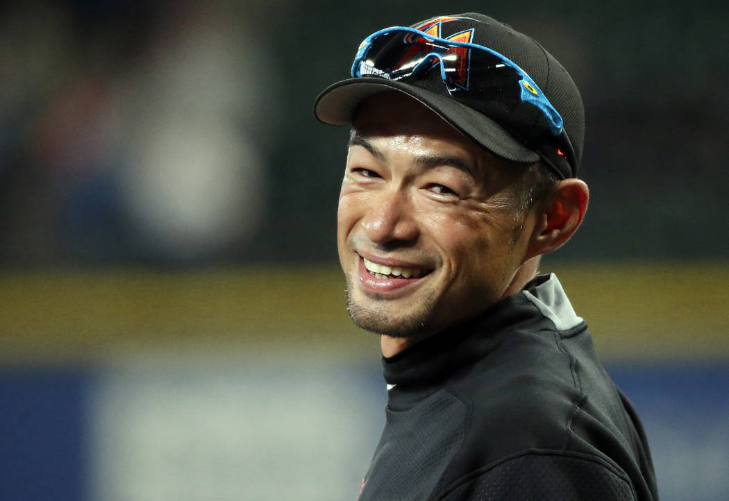 In this April 17, 2017, file photo, Miami Marlins' Ichiro Suzuki smiles to fans as he takes the field during batting practice before a baseball game against his former team, the Seattle Mariners,  ...