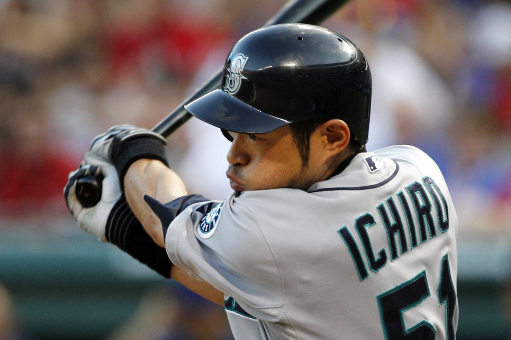 In this May 29, 2012, file photo, Seattle Mariners' Ichiro Suzuki bats against the Texas Rangers during a baseball game in Arlington, Texas. (AP Photo/Tony Gutierrez, File)