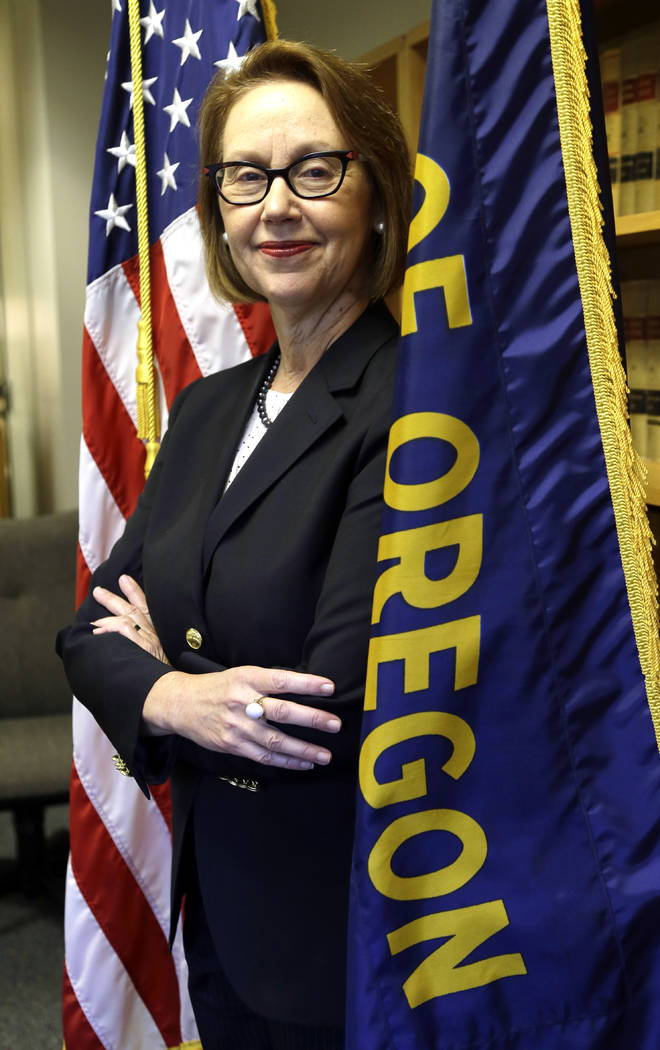 Oregon Attorney General Ellen Rosenblum poses for a photo at her office in Portland, Ore., July 13, 2016. The state of Oregon has sued Nevada gambling mogul Steve Wynn and the board of directors o ...