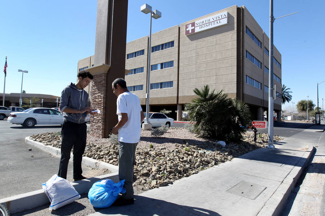 Carlos Sanchez, 61, right, gets help gathering his belongings from his son, Jacob Edward Delgado, 23, after being released from North Vista Hospital's psychiatric ward Friday, March 9, 2018. K.M.  ...