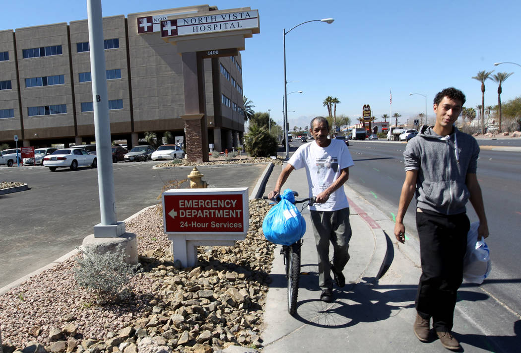 Carlos Sanchez, 61, left, and his son, Jacob Edward Delgado, 23, walk to a bus stop after being released from North Vista Hospital's psychiatric ward Friday, March 9, 2018. K.M. Cannon Las Vegas R ...