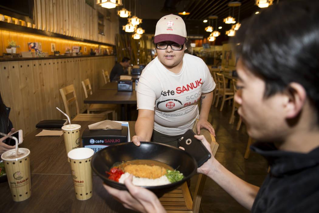 Baleria Rodriguez delivers an entree to a customer at Cafe Sanuki in Las Vegas, Thursday, March 8, 2018. Erik Verduzco Las Vegas Review-Journal @Erik_Verduzco