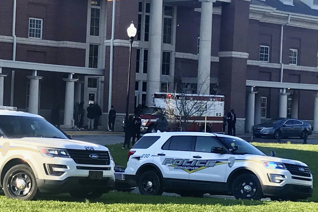 Authorities investigate the scene where a shooting occurred at Huffman High School, Wednesday, March 7, 2018, in Birmingham, Ala. (Carol Robinson/AL.com via AP)