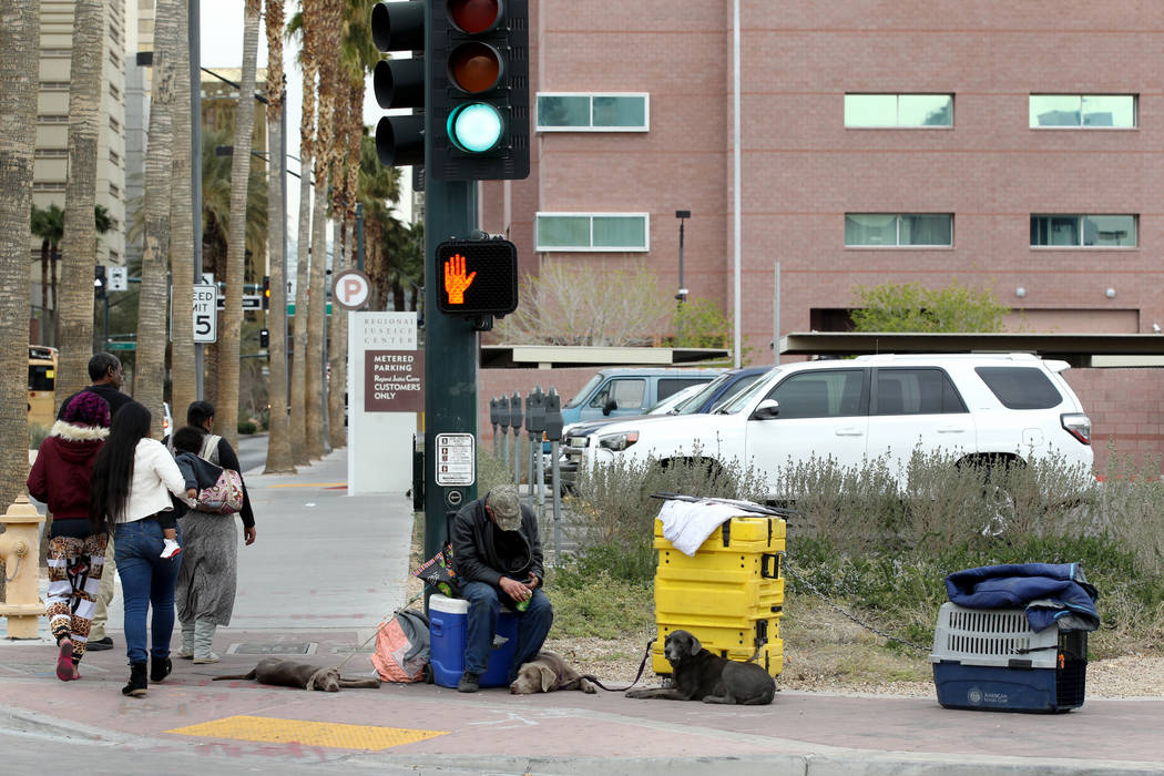 People pass the corner of South Casino Center Boulevard and West Bonneville Avenue in downtown Las Vegas Wednesday, March 7, 2018. K.M. Cannon Las Vegas Review-Journal @KMCannonPhoto