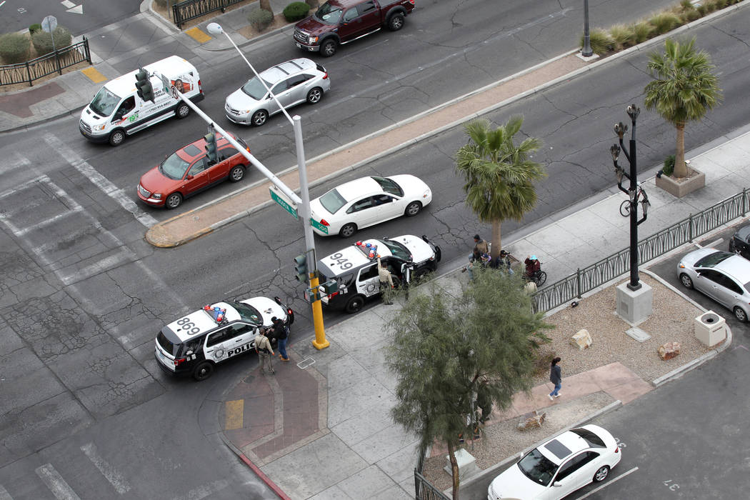 Las Vegas police make a stop on the corner of Ogden Avenue and Las Vegas Boulevard North in downtown Las Vegas Wednesday, March 7, 2018. K.M. Cannon Las Vegas Review-Journal @KMCannonPhoto