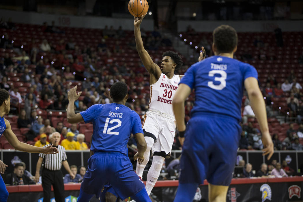 UNLV Rebels guard Jovan Mooring (30) takes a shot at the basket as Air Force Falcons forward Lavelle Scottie (12) looks on in the first half of the Mountain West Conference men's basketball tourna ...