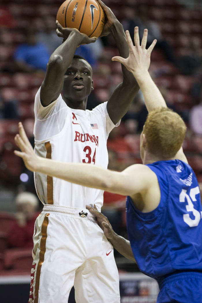 UNLV Rebels forward Cheikh Mbacke Diong (34) shoots for a score in the first half of the Mountain West Conference men's basketball tournament game at the Thomas & Mack Center in Las Vegas, Wed ...