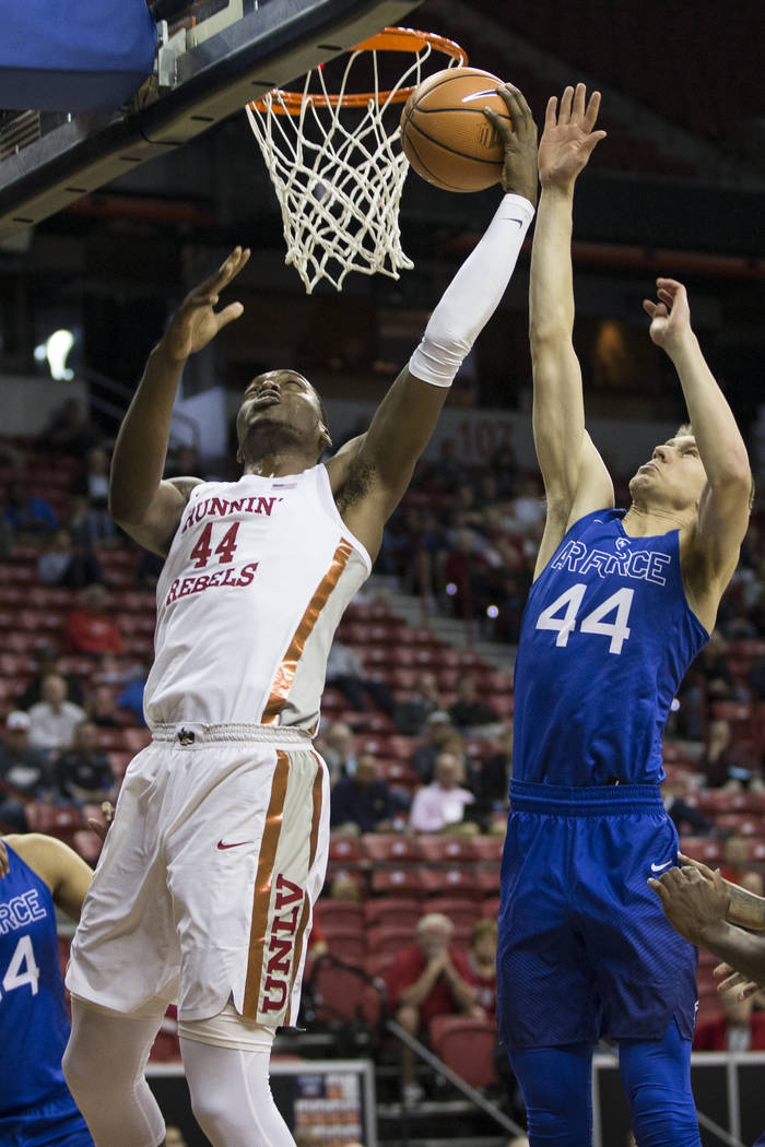 UNLV Rebels forward Brandon McCoy (44) shoots for a score against pressure from Air Force Falcons guard Keaton Van Soelen (44) in the first half of the Mountain West Conference men's basketball to ...