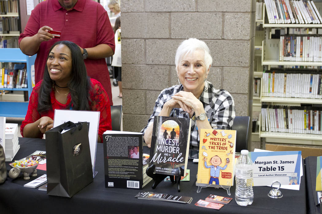 Southern Nevada author Morgan St. James, right,  greets visitors at last year's Local Author's Showcase. (Photo courtesy Henderson Libraries)