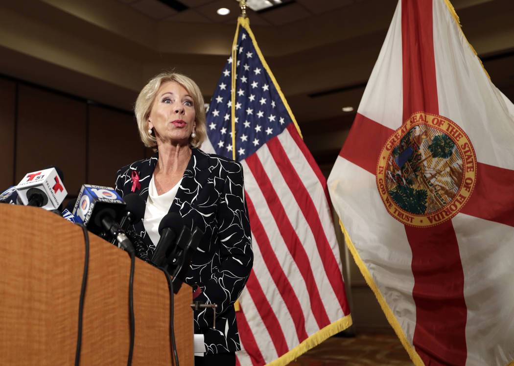 Secretary of Education Betsy DeVos speaks at a news conference following a visit to Marjory Stoneman Douglas High School in the aftermath of the Feb. 14 mass shooting at the school, Wednesday, Mar ...