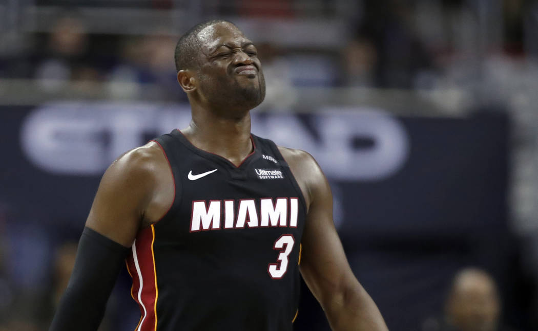Miami Heat guard Dwyane Wade reacts after a foul during the overtime period an NBA basketball game against the Washington Wizards, Tuesday, March 6, 2018, in Washington. The Wizards won 117-113. ( ...