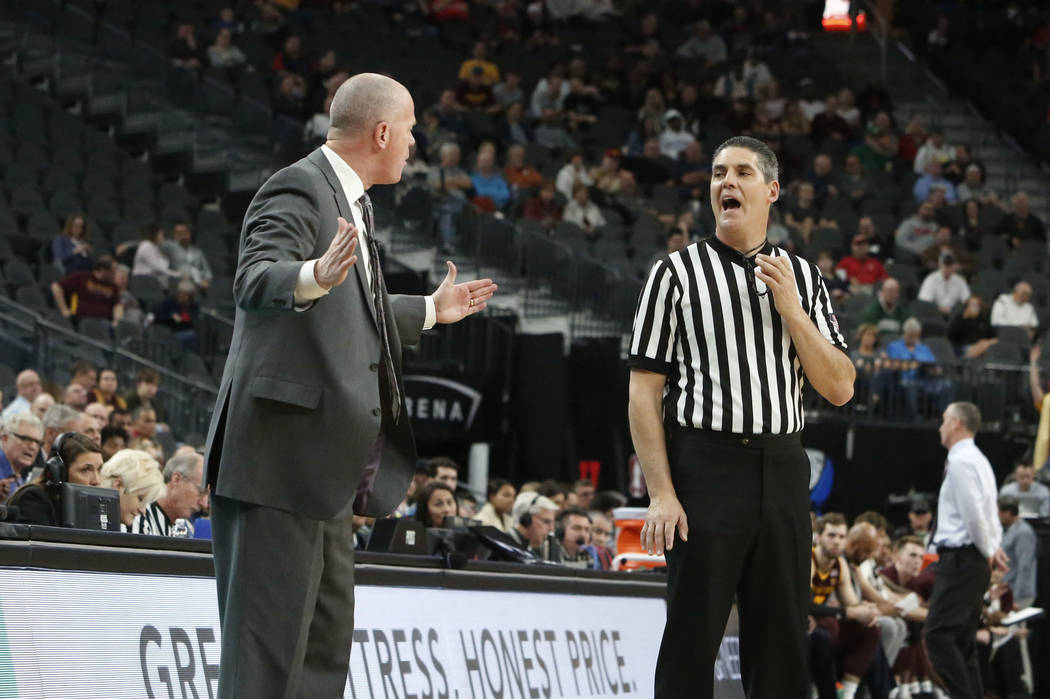 Colorado Buffaloes' head coach Tad Boyle argues with an official during an NCAA college basketball game against Arizona State in the first round of the Pac-12 tournament on Wednesday, March 7, 201 ...