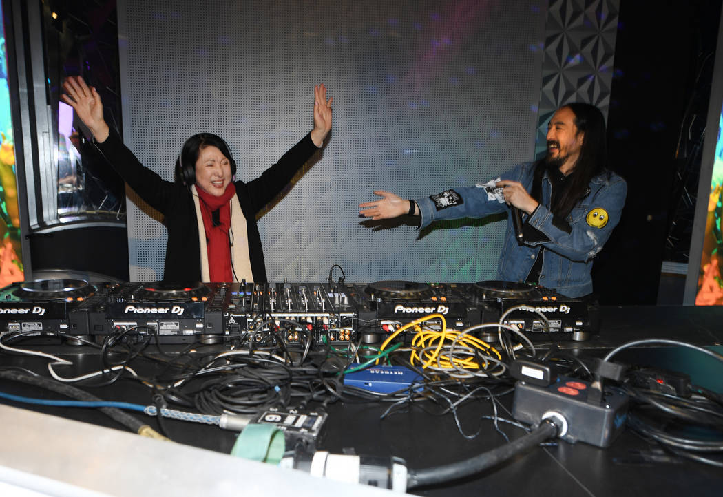 Steve Aoki grooves it up with his mother, Chizuru Aoki, during the unveiling of his wax figure at Madame Tussauds at The Venetian on Tuesday, March 6, 2018. (Denise Truscello)