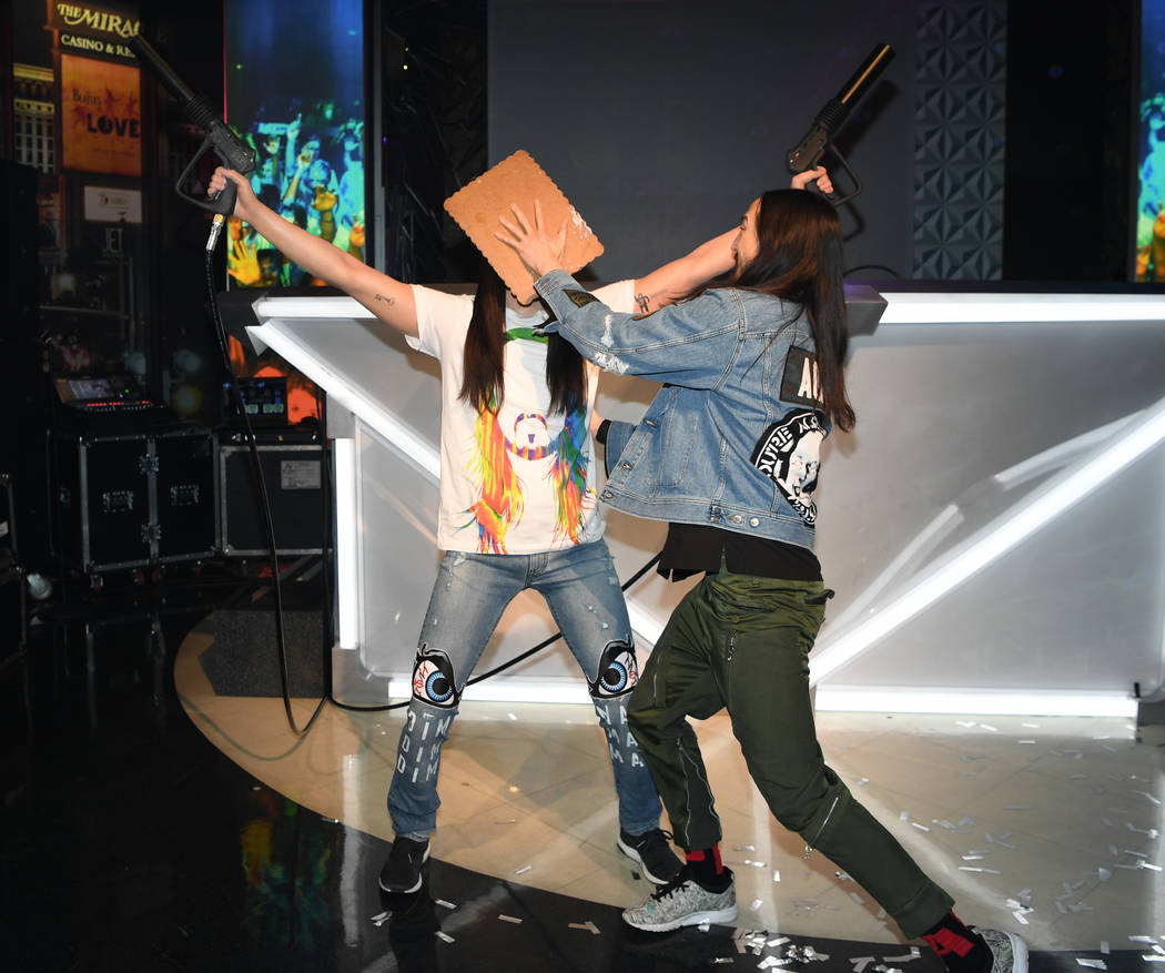 "Steve Aoki is shown ""caking"" his wax figure at Madame Tussauds at The Venetian on Tuesday, March 6, 2018. (Denise Truscello)"
