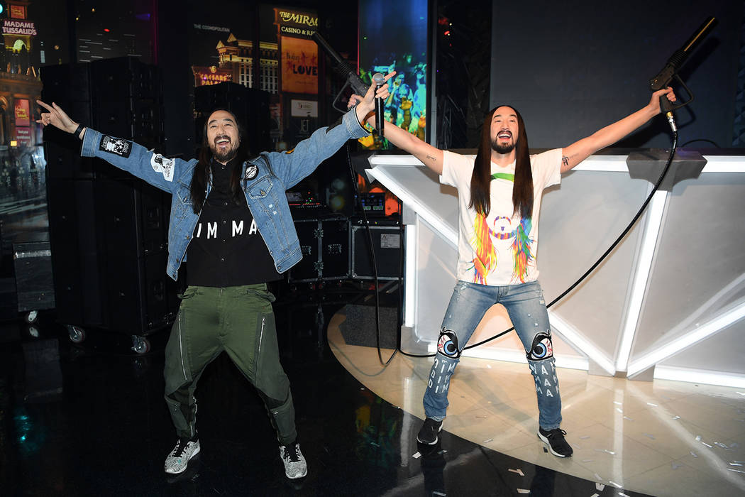 The real Steve Aoki, left, poses with his wax image at Madame Tussauds at The Venetian on Tuesday, March 6, 2018. (Denise Truscello)