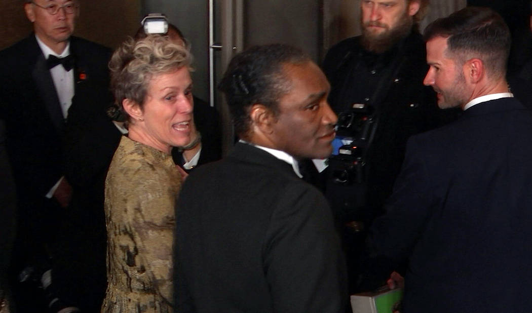 This image taken from video shows Oscar winner Frances McDormand, foreground left, walking into the Governors Ball next to Terry Bryant, center, the man accused of stealing her Academy Award on Su ...