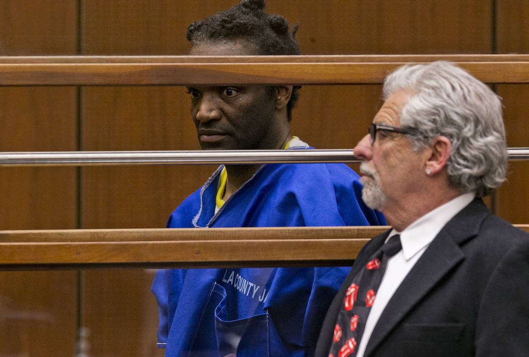 Terry Bryant, left, appears with his attorney Daniel Brookman in Los Angeles Superior Court Wednesday, March 7, 2018. Bryant, who is charged with stealing Frances McDormand's best actress Oscar wi ...