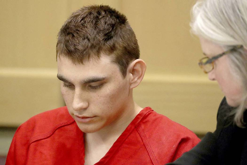 In this Feb. 19, 2018 file photo, Nikolas Cruz, accused of killing 17 people in the Florida high school shooting, appears in court for a status hearing in Fort Lauderdale, Fla. Cruz was formally c ...