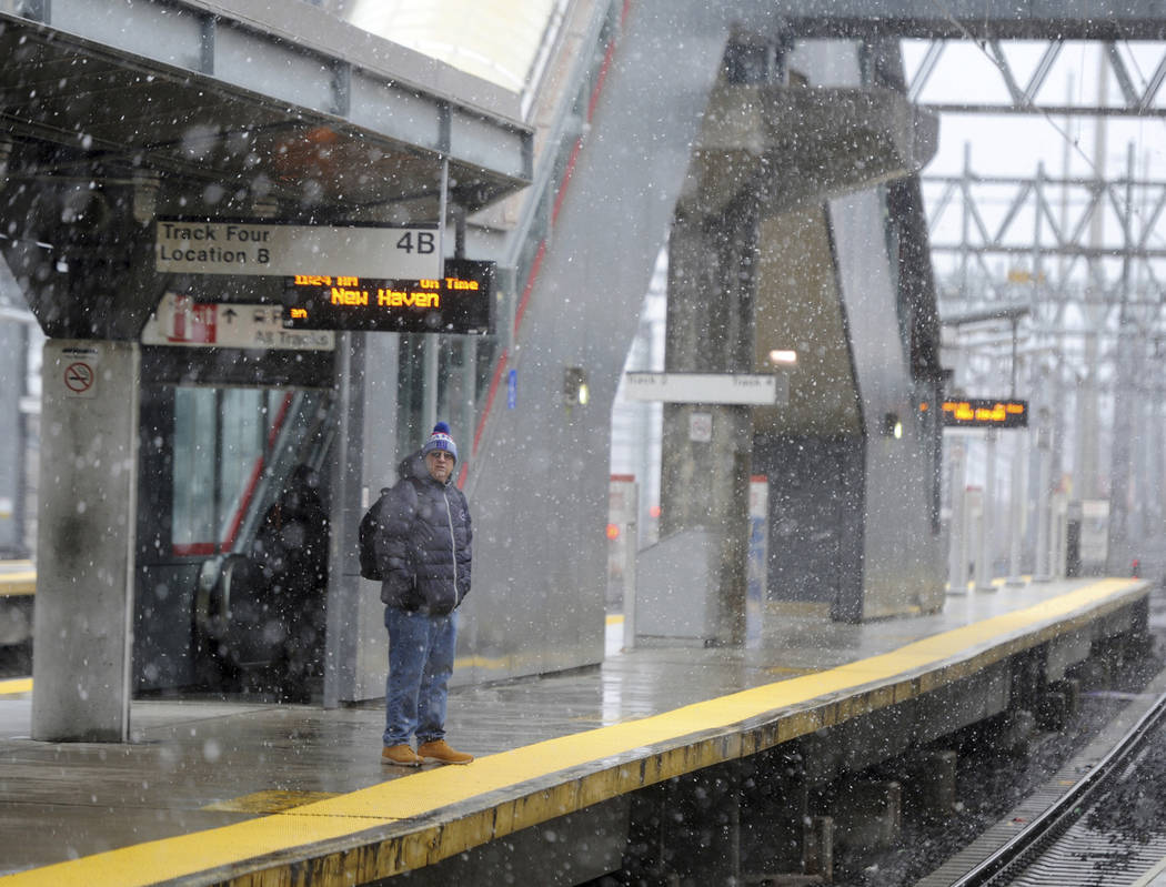 A lone commuter waits at the train station as snow falls in Stamford, Conn., Wednesday, March 7, 2018. Connecticut is expected to receive anywhere from 4 to 16 inches of snow. (Tyler Sizemore/Hear ...