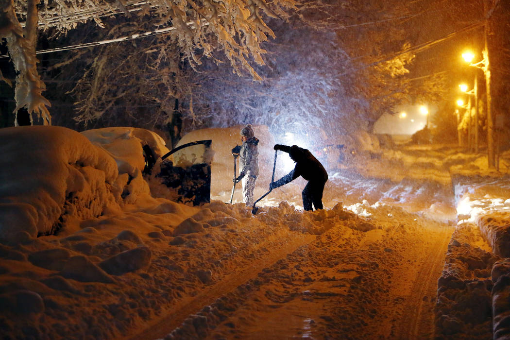 Residents on Mills Street dig out their car after a snowstorm dumped over a foot of snow around the area Wednesday, March 7, 2018, in Morristown, N.J. The storm carrying wind, rain and heavy snow  ...