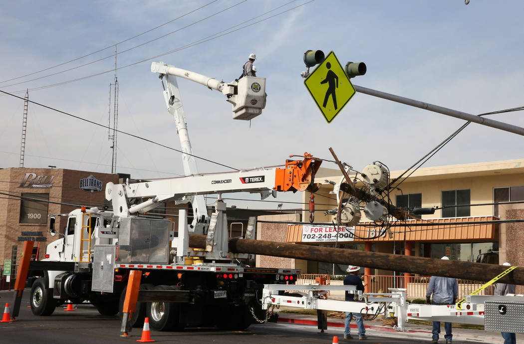 NV Energy workers prepare to remove and replace a broken wood electric pole at Industrial Park, near Sahara Avenue, on Thursday, March 8, 2018, in Las Vegas. Bizuayehu Tesfaye/Las Vegas Review-Jou ...