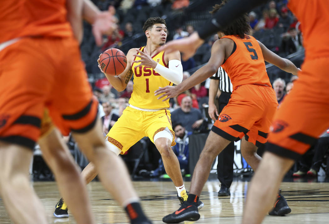 USC Trojans guard Jordan Usher (1) looks to get past Oregon State Beavers defenders during the Pac-12 basketball tournament at T-Mobile Arena in Las Vegas on Thursday, March 8, 2018. Chase Stevens ...
