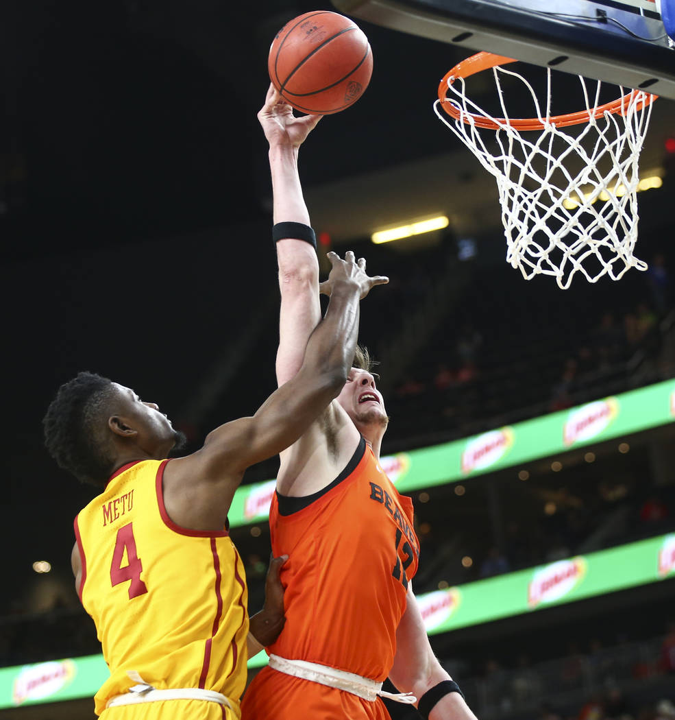 Oregon State Beavers forward Drew Eubanks (12) gets fouled by USC Trojans forward Chimezie Metu (4) during the Pac-12 basketball tournament at T-Mobile Arena in Las Vegas on Thursday, March 8, 201 ...