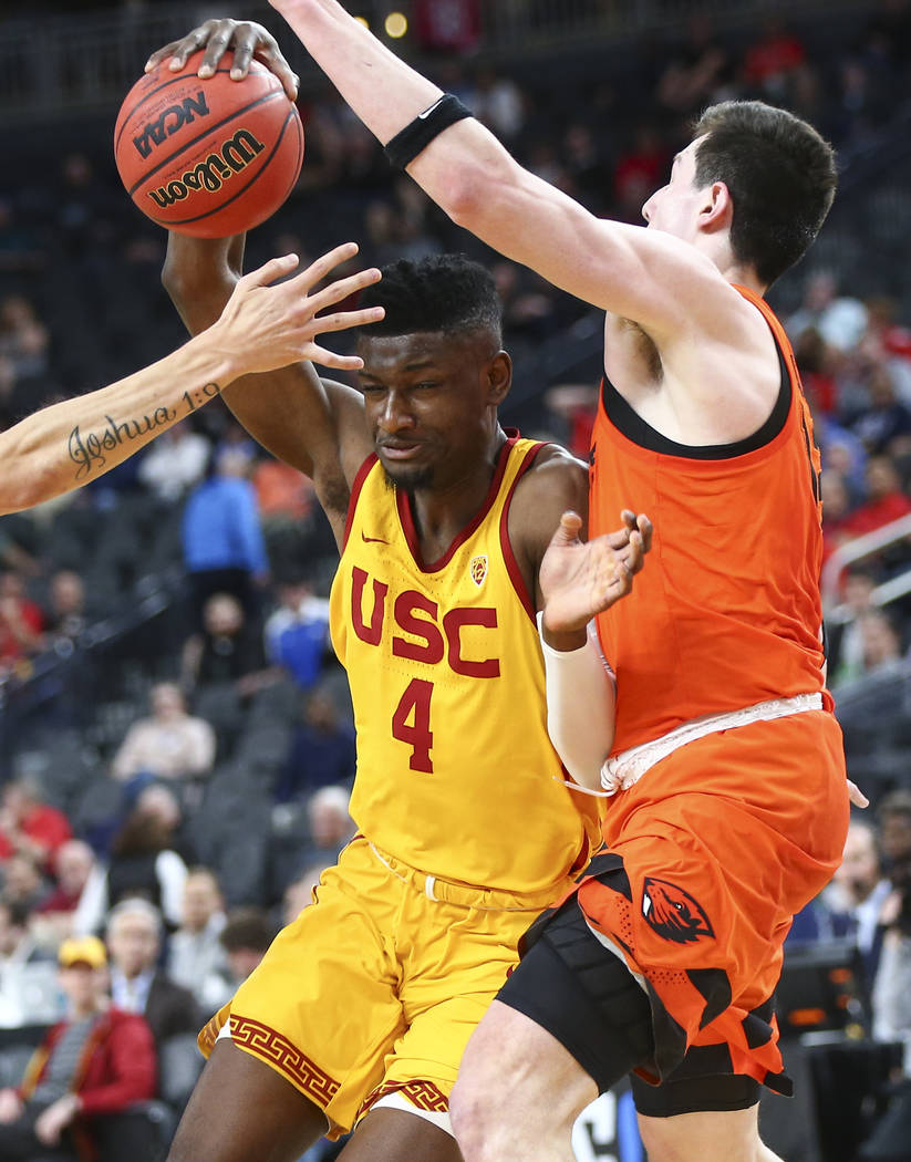 USC Trojans forward Chimezie Metu (4) drives to the basket as Oregon State Beavers forward Drew Eubanks (12) defends during the Pac-12 basketball tournament at T-Mobile Arena in Las Vegas on Thurs ...