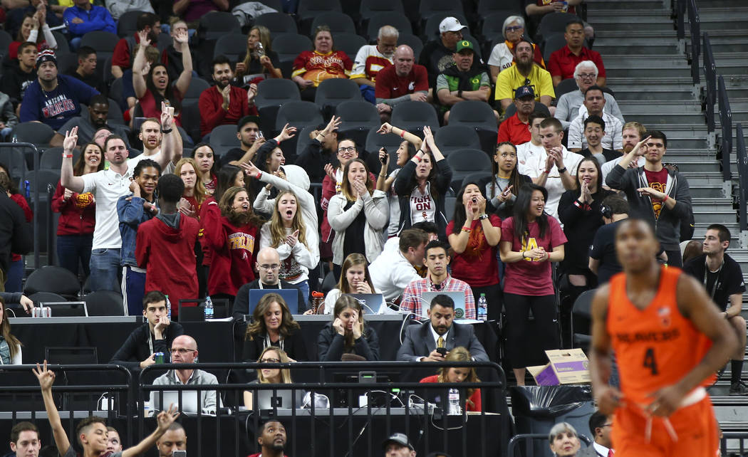 USC Trojans fans react as their team plays the Oregon State Beavers during the Pac-12 basketball tournament at T-Mobile Arena in Las Vegas on Thursday, March 8, 2018. Chase Stevens Las Vegas Revie ...
