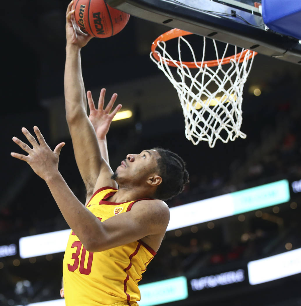 USC Trojans guard Elijah Stewart (30) goes to the basket against the Oregon State Beavers during the Pac-12 basketball tournament at T-Mobile Arena in Las Vegas on Thursday, March 8, 2018. Chase S ...