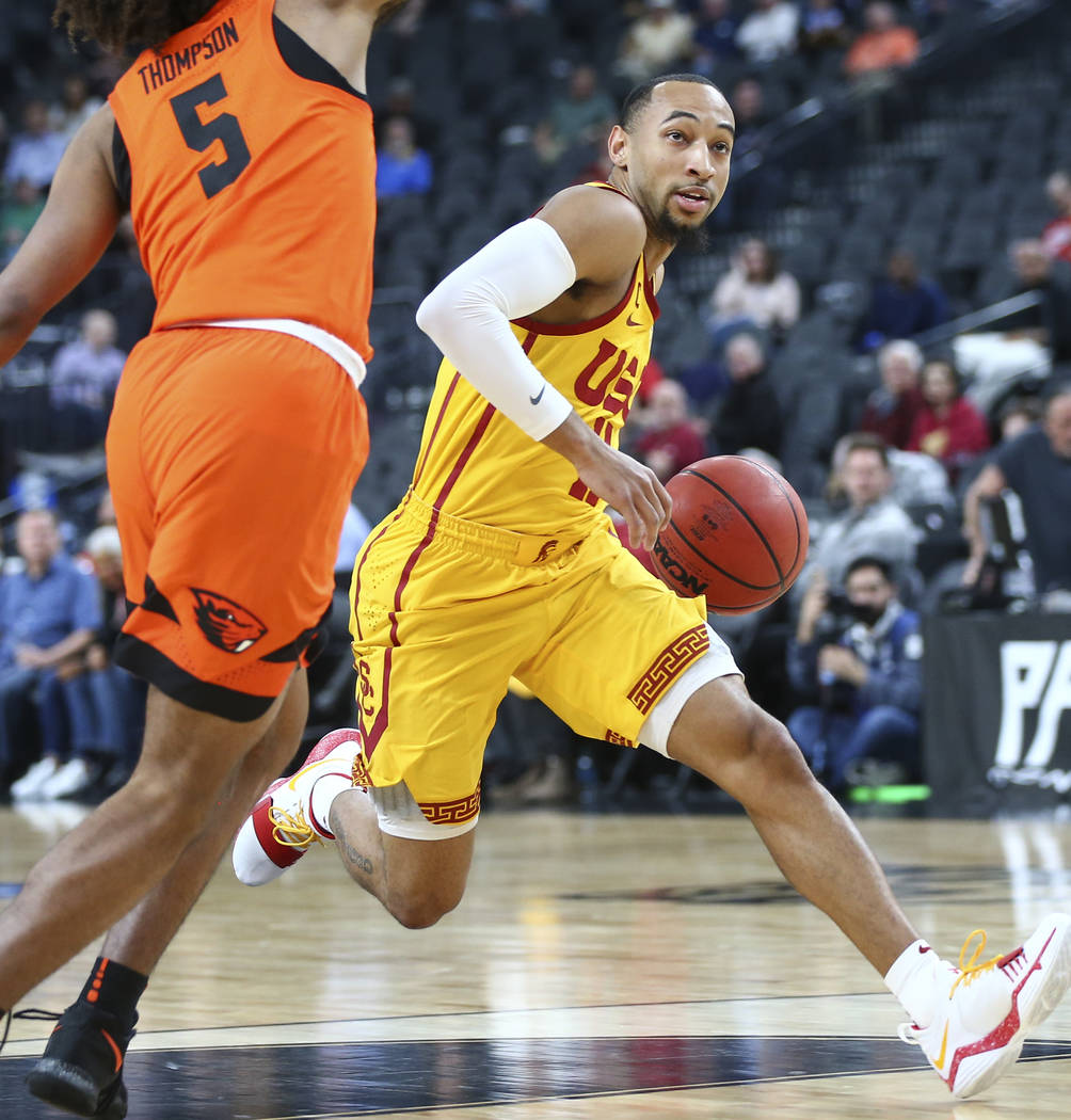 USC Trojans guard Jordan McLaughlin (11) drives around Oregon State Beavers guard Ethan Thompson (5) during the Pac-12 basketball tournament at T-Mobile Arena in Las Vegas on Thursday, March 8, 20 ...