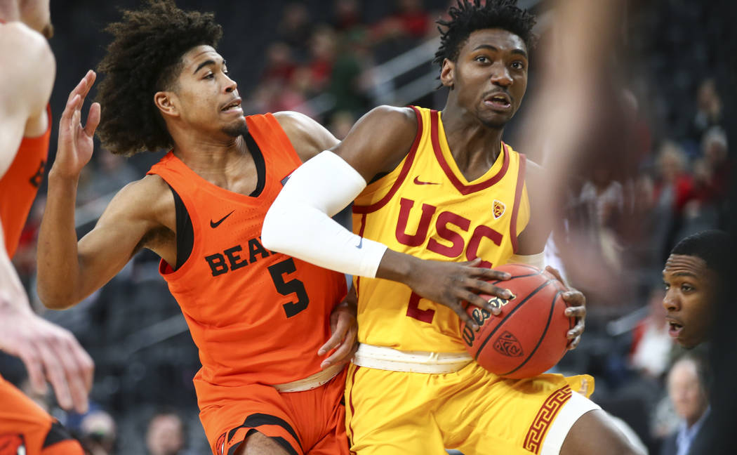 USC Trojans guard Jonah Mathews (2) drives the ball as Oregon State Beavers guard Ethan Thompson (5) defends during the Pac-12 basketball tournament at T-Mobile Arena in Las Vegas on Thursday, Mar ...