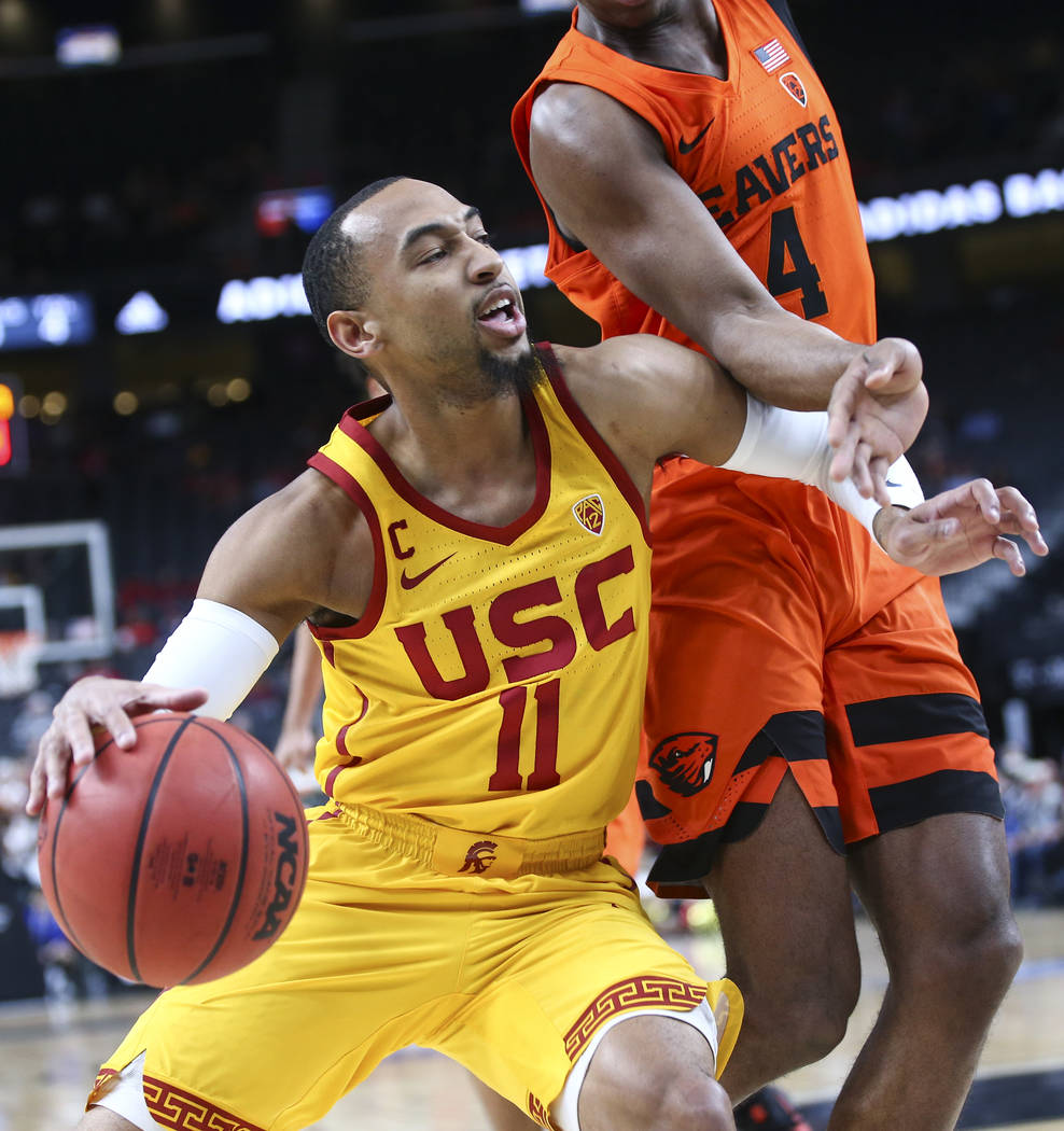 USC Trojans guard Jordan McLaughlin (11) drives as Oregon State Beavers forward Alfred Hollins (4) defends during the Pac-12 basketball tournament at T-Mobile Arena in Las Vegas on Thursday, March ...