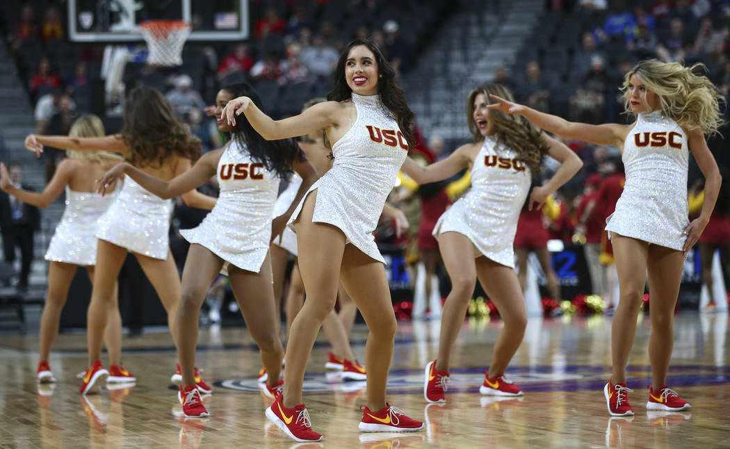 USC Trojans cheerleaders perform during a break as their team plays the Oregon State Beavers during the Pac-12 basketball tournament at T-Mobile Arena in Las Vegas on Thursday, March 8, 2018. Chas ...