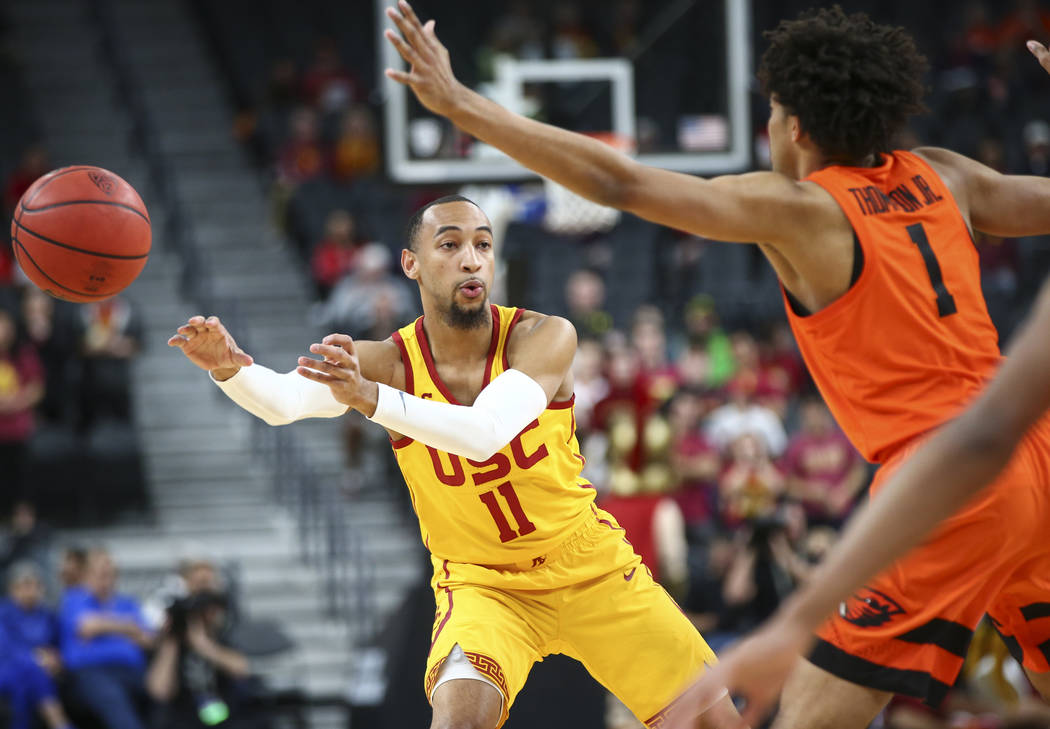 USC Trojans guard Jordan Usher (1) passes the ball while playing the Oregon State Beavers during the Pac-12 basketball tournament at T-Mobile Arena in Las Vegas on Thursday, March 8, 2018. Chase S ...