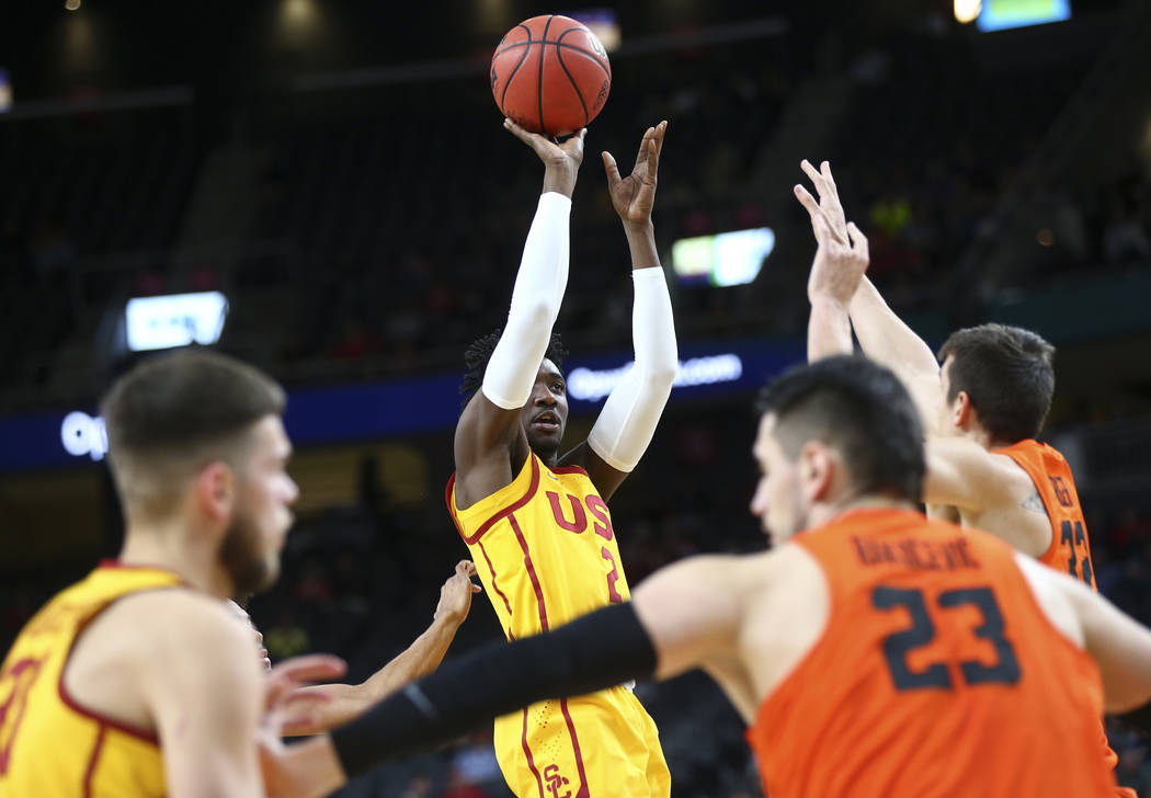 USC Trojans guard Jonah Mathews (2) shoots against the Oregon State Beavers during the Pac-12 basketball tournament at T-Mobile Arena in Las Vegas on Thursday, March 8, 2018. Chase Stevens Las Veg ...