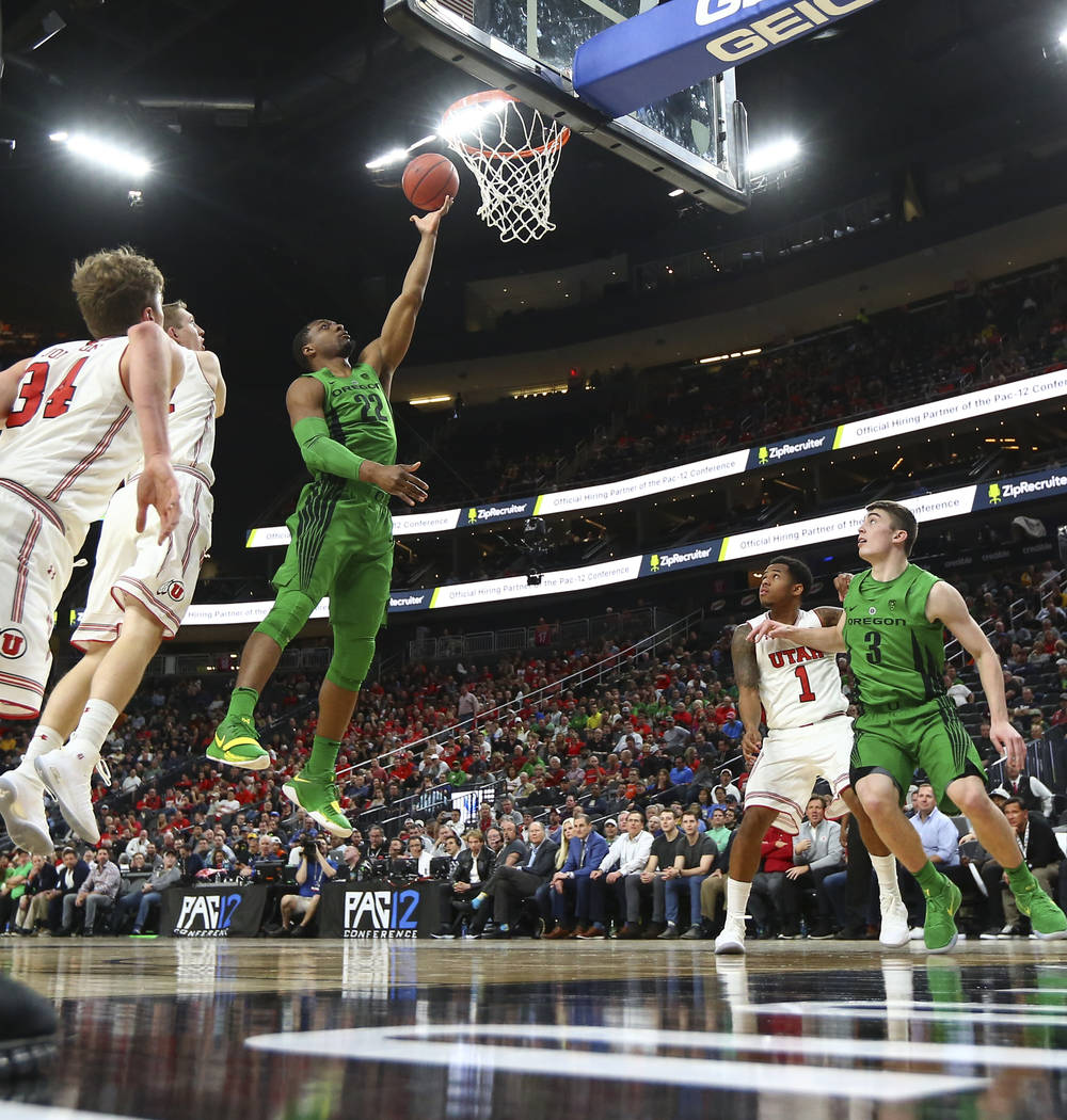 Oregon Ducks forward MiKyle McIntosh (22) goes to the basket against the Utah Utes during the Pac-12 basketball tournament at T-Mobile Arena in Las Vegas on Thursday, March 8, 2018. Chase Stevens  ...