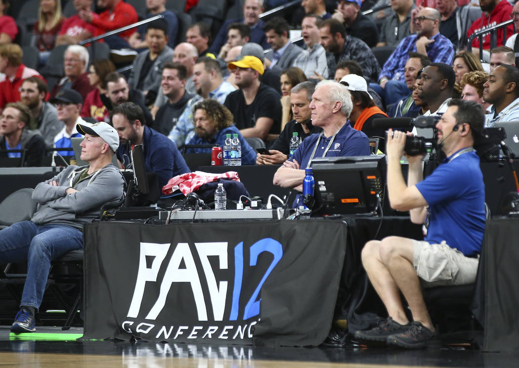Famed basketball player and sports analyst Bill Walton, center left, watches the Oregon Ducks play the Utah Utes during the Pac-12 basketball tournament at T-Mobile Arena in Las Vegas on Thursday, ...