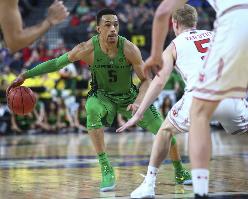 Oregon Ducks guard Elijah Brown (5) drives as Utah Utes guard Parker Van Dyke (5) defends during the Pac-12 basketball tournament at T-Mobile Arena in Las Vegas on Thursday, March 8, 2018. Chase S ...
