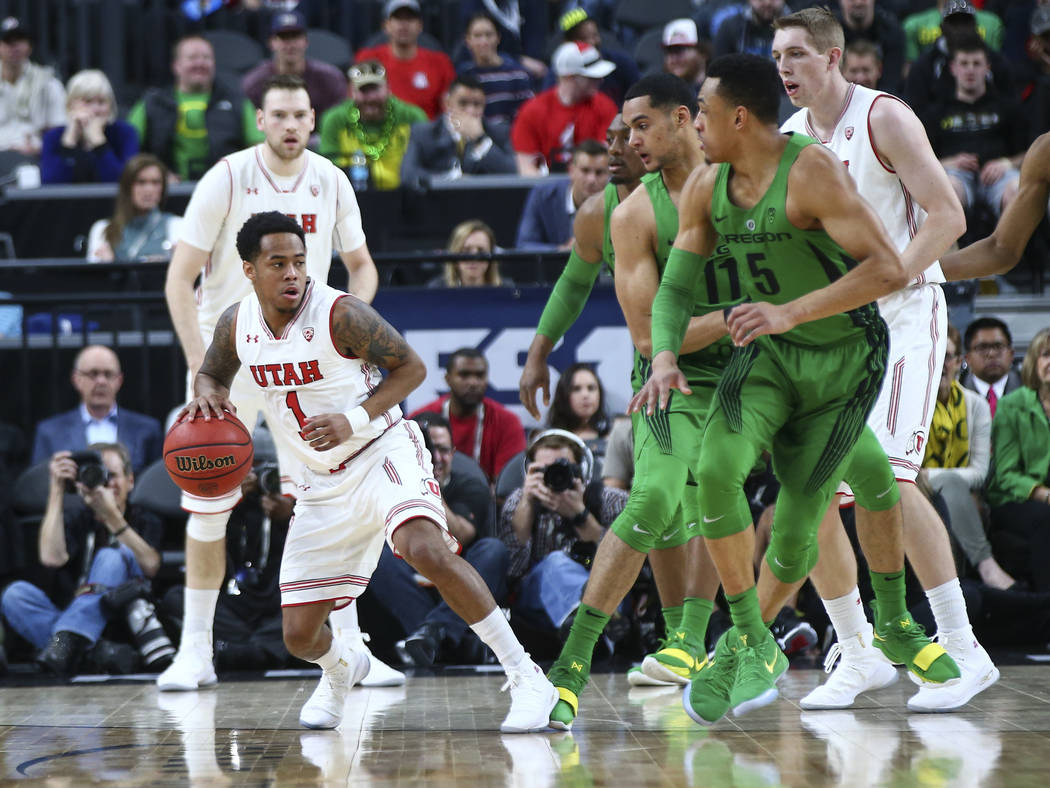 Utah Utes guard Justin Bibbins (1) looks to get around Oregon Ducks defense during the Pac-12 basketball tournament at T-Mobile Arena in Las Vegas on Thursday, March 8, 2018. Chase Stevens Las Veg ...