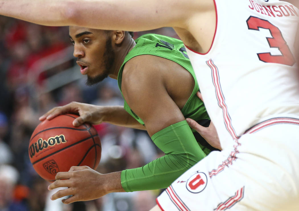 Oregon Ducks forward Troy Brown (0) drives as Utah Utes forward Jayce Johnson (34) defends during the Pac-12 basketball tournament at T-Mobile Arena in Las Vegas on Thursday, March 8, 2018. Chase  ...