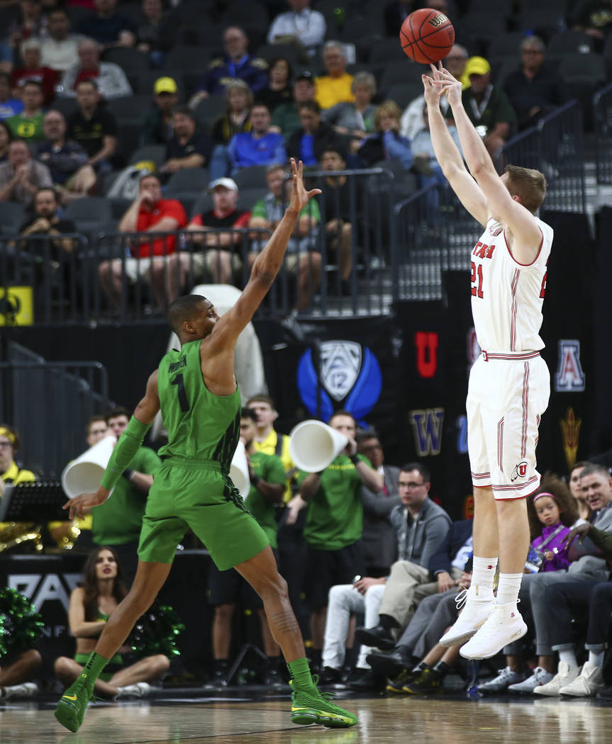 Utah Utes forward Tyler Rawson (21) shoots over Oregon Ducks forward Kenny Wooten (1) during the Pac-12 basketball tournament at T-Mobile Arena in Las Vegas on Thursday, March 8, 2018. Chase Steve ...