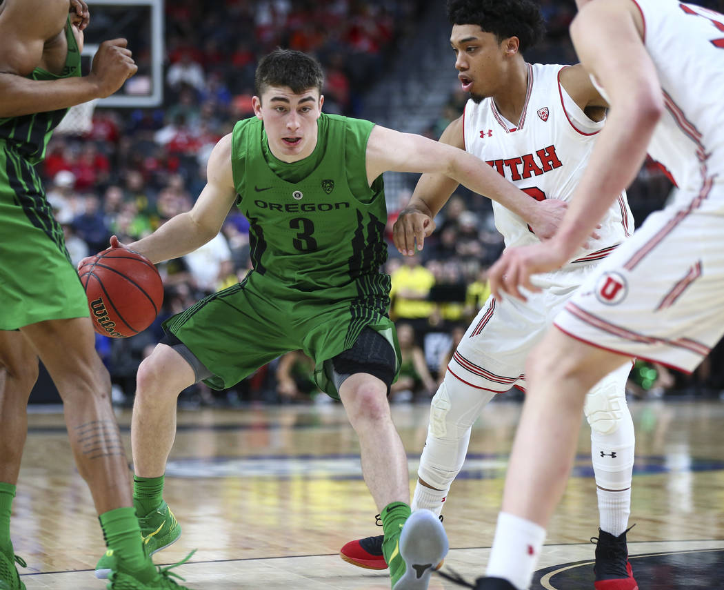Utah Utes forward Donnie Tillman (3) drives past Utah Utes forward Donnie Tillman, right, during the Pac-12 basketball tournament at T-Mobile Arena in Las Vegas on Thursday, March 8, 2018. Chase S ...