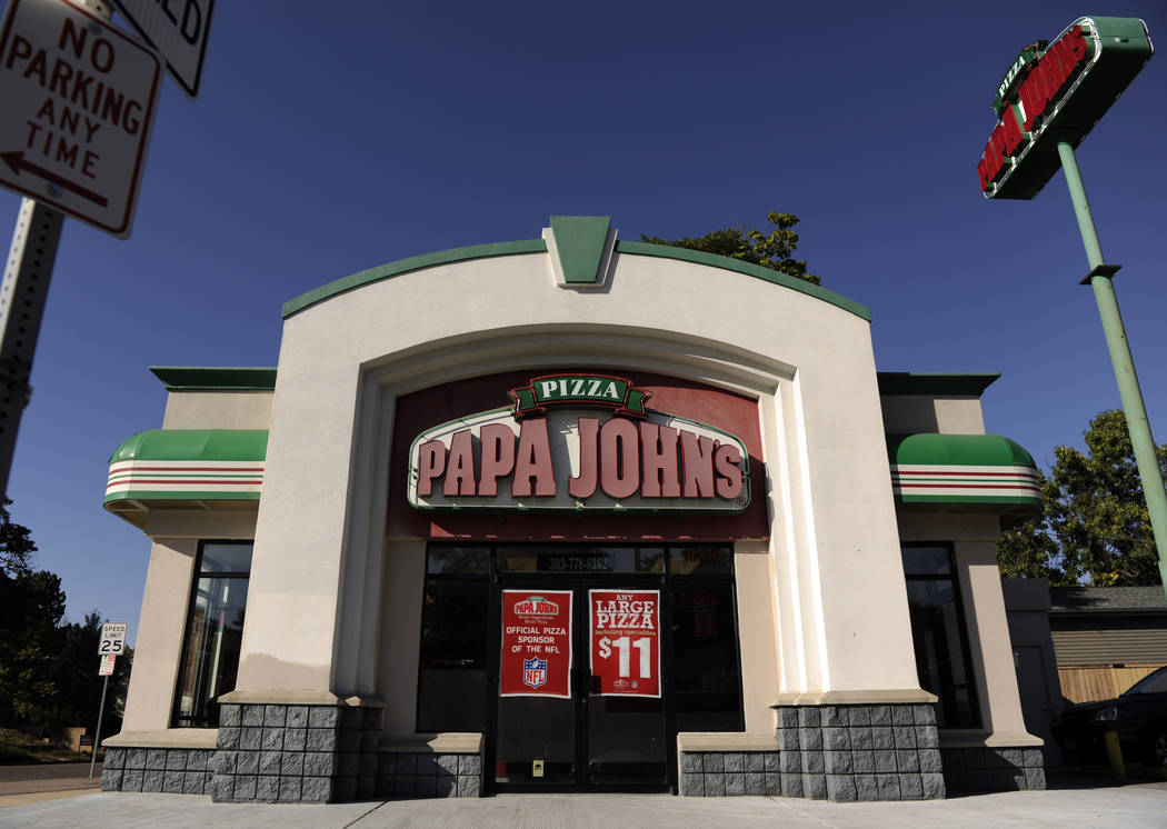 A Sept. 29, 2011, photo shows a Papa John's location in Denver. Peyton Manning sold his share in 31 Denver-area Papa John's stores last week, two days before the NFL dropped the chain as its offic ...