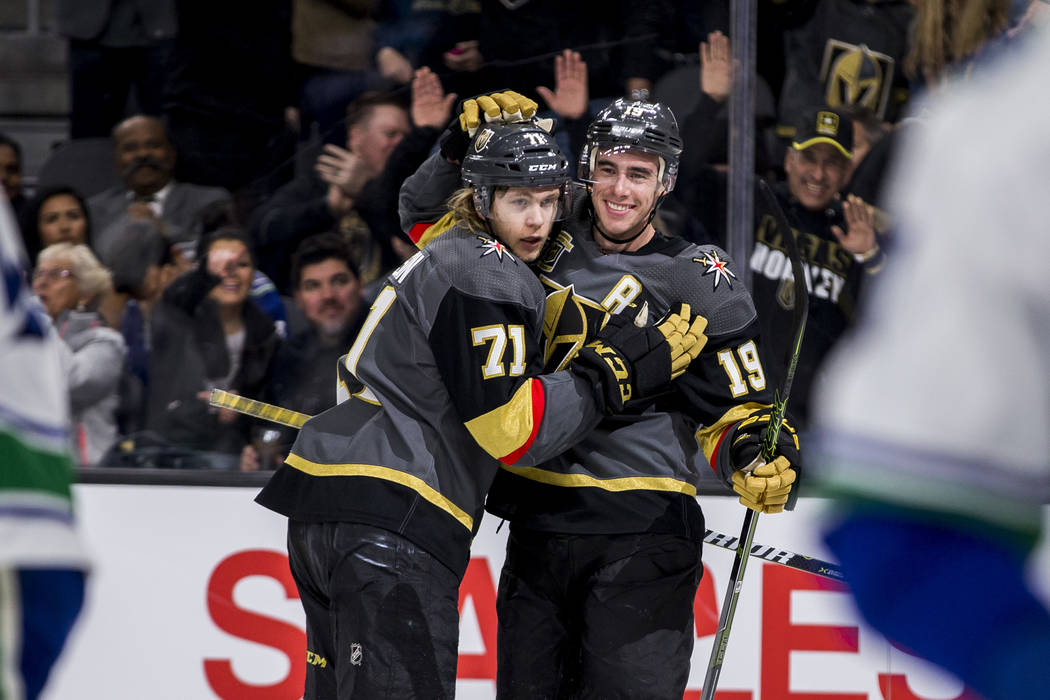 Golden Knights center William Karlsson (71) and Vegas Golden Knights right wing Reilly Smith (19) celebrate after Karlsson scored the Knights' second goal of the game during the first period of an ...
