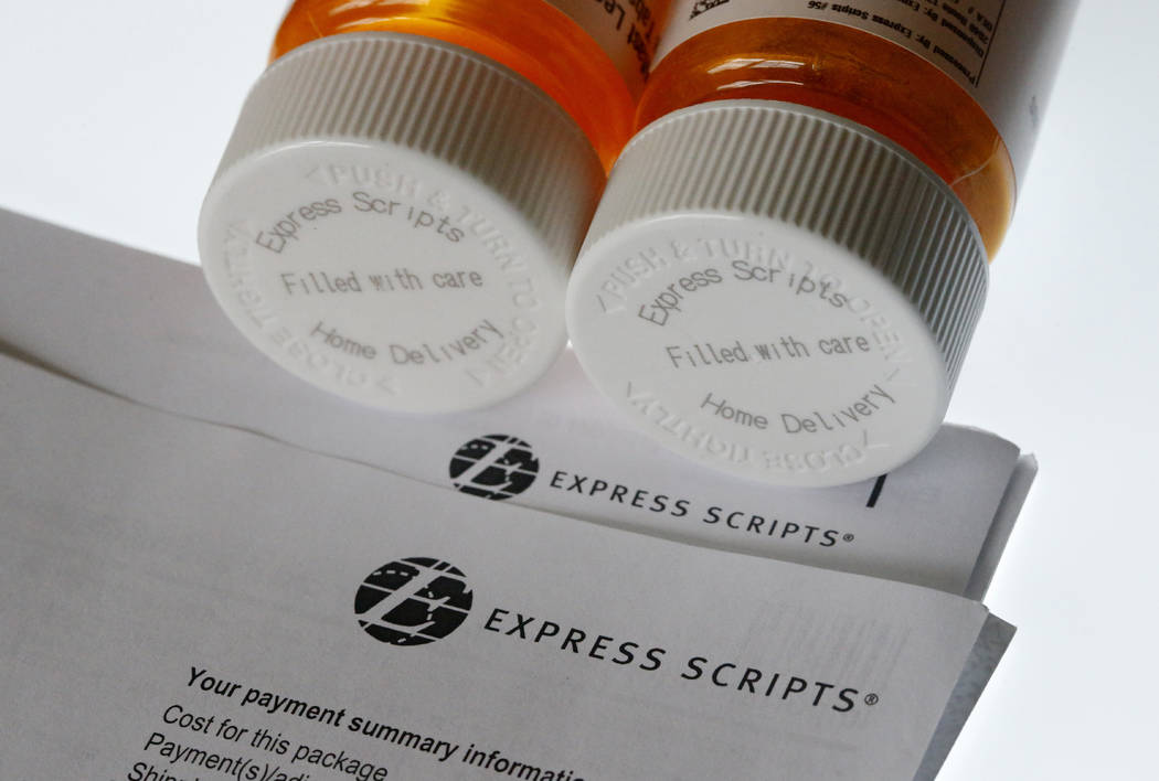 Express Scripts prescription medication bottles are arranged for a photo in Surfside, Fla., July 25, 2017. Health insurer Cigna will spend about $52 billion to acquire the pharmacy benefits manage ...